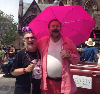 Woody and Alan at Pride under pink umbrella