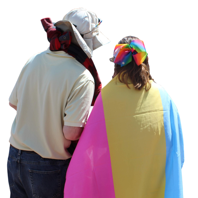 Backs of two people with one wearing pansexual flag as cape
